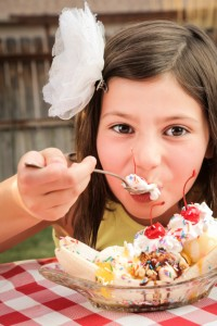 Little Girl eating a sundae